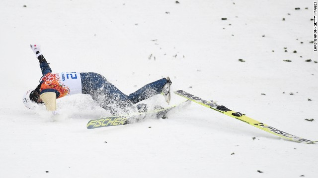 Taihei Kato of Japan crashes as he competes in the large hill Nordic combined event on February 18.