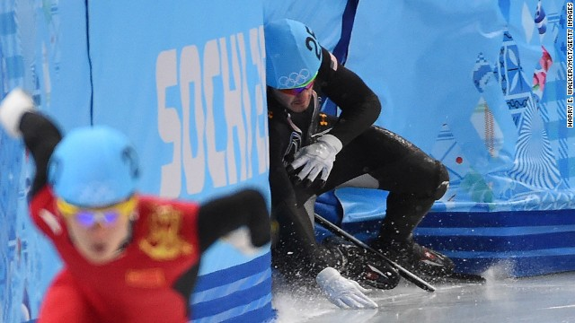 American Eduardo Alvarez loses his balance and crashes into the wall February 18 during a 500-meter short track speedskating race.