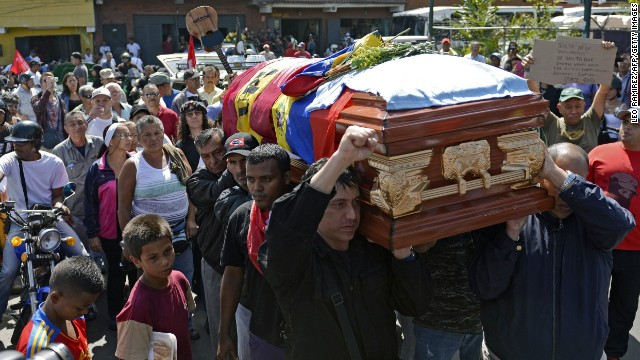 On Thursday, February 13, relatives, friends and pro-government supporters carry the coffin of a man who was killed during a protest in Caracas.