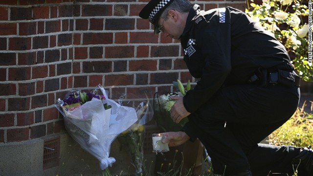 Tributes are placed at the house of the al-Hilli family on September 7, 2012 in Claygate, England.