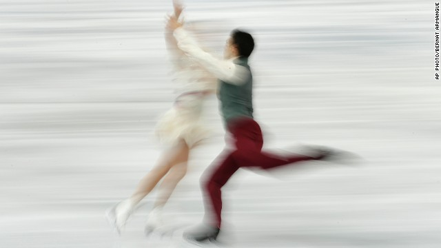 FEBRUARY 18 - SOCHI, RUSSIA: Anna Cappellini and Luca Lanotte of Italy compete in the figure skating ice dance finals at the Iceberg Skating Palace on February 17. Highlights at the Winter Games today include men's ice hockey, as Russia must win its playoff match against Norway or face an embarrassing early exit. <a href='http://olympics.edition.cnn.com/Event/Sochi_2014_LIVE?hpt=isp_c1'>Follow all the live action here.</a>