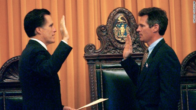Massachusetts Gov. Mitt Romney, left, swears in newly-elected state Sen. Scott Brown in Boston in March 2004. Brown won a special election to the post.