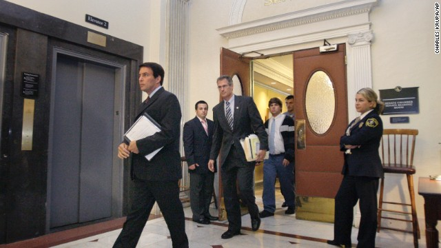 State Sen. Scott Brown (center) leaves the Massachusetts Senate chamber in Boston after it approved a bill allowing the governor to name an interim replacement for the late U.S. Sen. Edward Kennedy in September 2009.