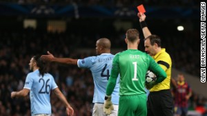 MANCHESTER, ENGLAND - FEBRUARY 18: Referee Jonas Eriksson shows a red card to Martin Demichelis of Manchester City during the UEFA Champions League Round of 16 first leg match between Manchester City and Barcelona at the Etihad Stadium on February 18, 2014 in Manchester, England. (Photo by Clive Brunskill/Getty Images)