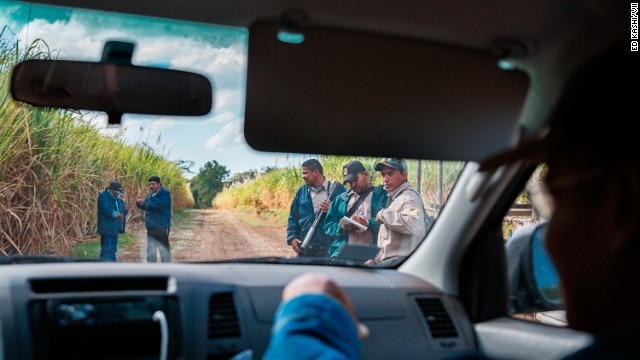 Security guards confront local workers and a member of La Isla Foundation for trespassing in the fields. La Isla is a nongovernmental organization addressing the increased incidence of kidney disease in the area.