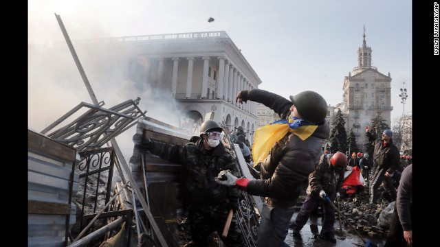 A protester throws a stone in Kiev on February 19.