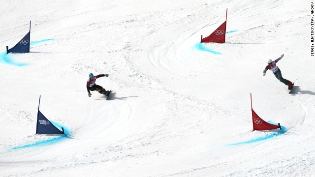 Snowboarders Alexander Bergmann of Germany, left, and Rok Flander of Slovenia compete in the parallel giant slalom on February 19.