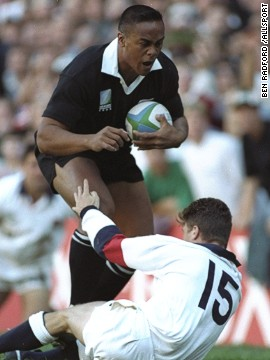 This picture of full-back Mike Catt being trampled over by Lomu summed up the helplessness of England's players in the face of the warrior All Black. New Zealand won the game 45-29 but lost to South Africa in the final.