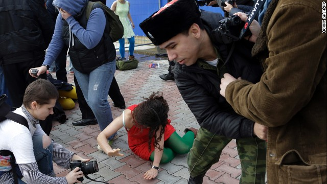 "A member of Pussy Riot lies on the ground February 19. The band has been highly critical of Russian President Vladimir Putin and his policies, and Alyokhina and Tolokonnikova were even imprisoned for a 2012 ""punk prayer"" performance at a Russian Orthodox cathedral."