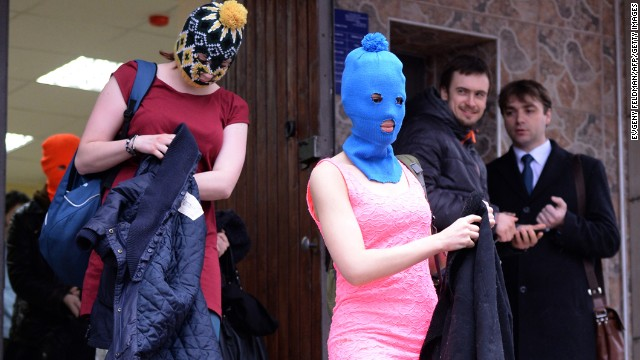 Tolokonnikova, wearing the blue mask, and other band members leave the police station on February 18.