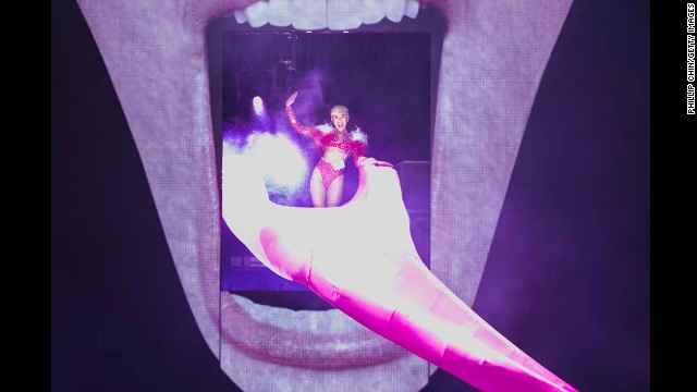 Cyrus opens her Bangerz Tour on February 14, 2014 in Vancouver, Canada. The stage features a giant image of Cyrus' face with her signature exposed tongue serving as a slide.