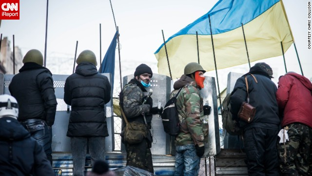 Protesters line up along barricades as Berkut police surround Maidan Nezalezhnosti, Kiev's central square, on February 18.