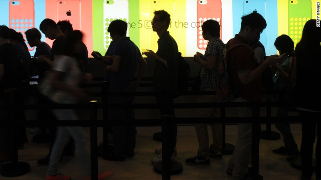 Apple broadened the acceptance of fingerprint scanning with the iPhone 5S' Touch ID sensor. In this picture, people queue outside an Apple store to purchase the new iPhone 5S and 5C in Hong Kong on September 20, 2013.