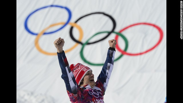 Russian snowboarder Vic Wild celebrates at the flower ceremony for the parallel giant slalom on February 19.
