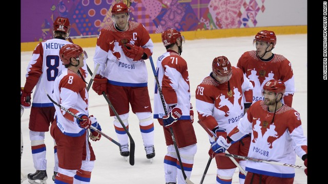 The men's hockey team from Russia looks dejected after losing to Finland on February 19.