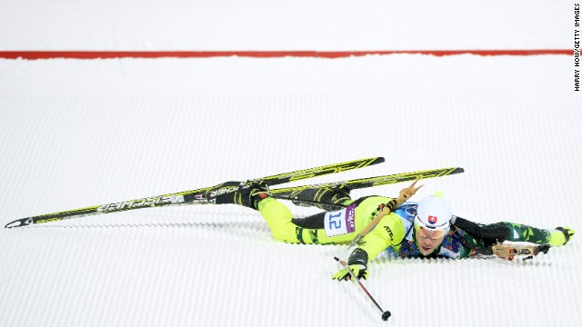 Biathlete Matej Kazar of Slovakia falls over the finish line during the mixed relay event on February 19.
