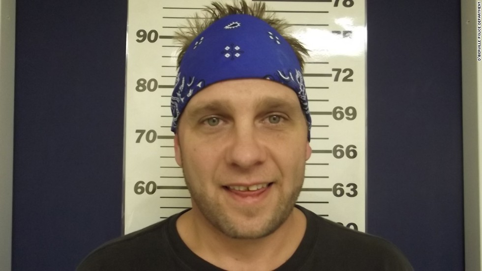3 Doors Down bassist Todd Harrell smiles for his mugshot after being <a href='http://www.cnn.com/2014/02/19/showbiz/three-doors-down-bassist-charged/index.html'>charged with driving under the influence</a>. He joins the club of other smiling celebs: