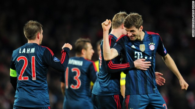 Thomas Muller headed home a late second to wrap up an impressive first leg victory at Emirates Stadium.