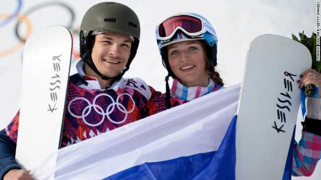 U.S.-born snowboarder Vic Wild took gold for his adopted nation Russia in the parallel giant slalom, while his wife Alena Zavarzina claimed bronze in the women's event won by Switzerland's Patrizia Kummer.