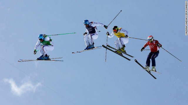 Athletes compete in the men's ski cross final on February 20.