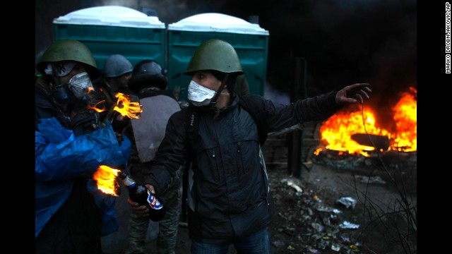 A protester gives directions before throwing Molotov cocktails on the outskirts of Independence Square on February 20.