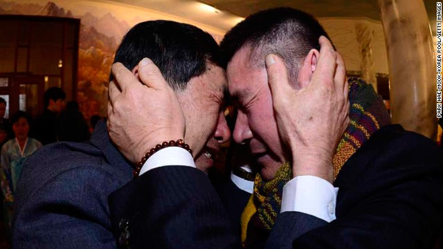 FEBRUARY 20 - MOUNT KUMGANG, NORTH KOREA: South Korean Park Yang-Gon (left) embraces his North Korean brother Park Yang-Soo during a family reunion after being separated for 60 years. The event, which allows <a href='http://cnn.com/2014/02/20/world/asia/koreas-reunion/index.html?hpt=hp_c3'>reunions of family members separated by the Korean War</a>, is a result of a recent agreement between North and South Korea that had been suspended since 2010.