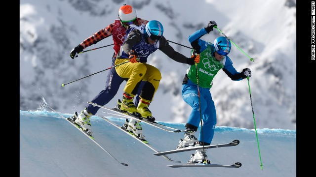 From left, Canada's Brady Leman, Germany's Thomas Fischer and Austria's Christoph Wahrstoetter compete in men's ski cross on February 20.