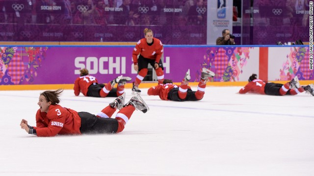 The Swiss women's hockey team celebrates after winning the bronze-medal game against Sweden on February 20.