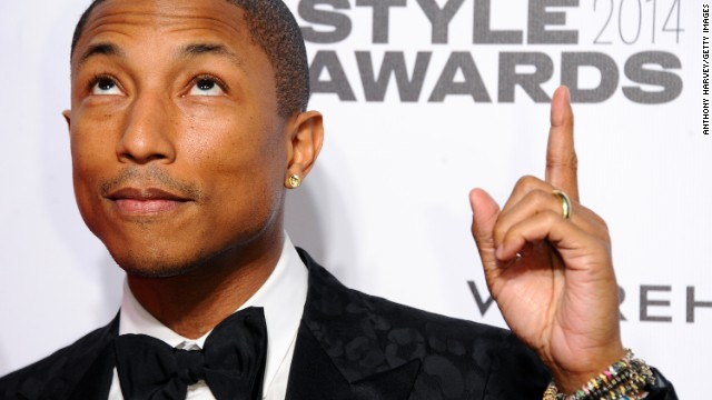 3dc352ba7fbe3 Pharrell Williams  impeccable style and boyish good looks -- as seen here  at the