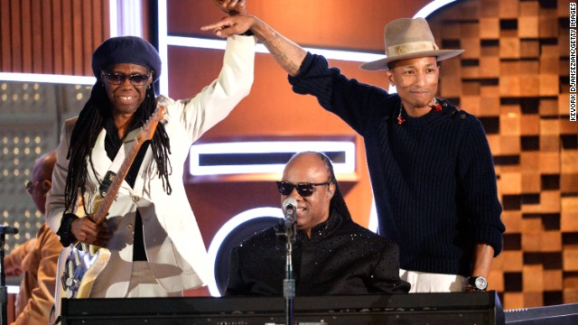 Then again, maybe Pharrell's passion for what he does helps him look so refreshed. He was clearly thrilled to take the stage with Nile Rodgers, left, and Stevie Wonder at the 2014 Grammys.
