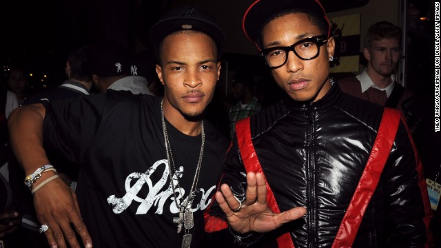 Seen here with T.I. in 2008, we bet you can't guess how old either of these music stars are. (Give up? T.I. was 28 while Pharrell was 35.)