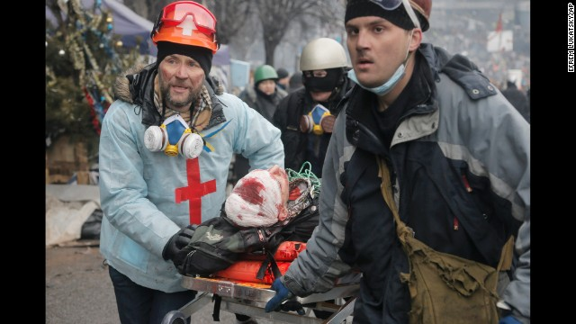 An injured protester is carried away from Independence Square on a stretcher February 20.