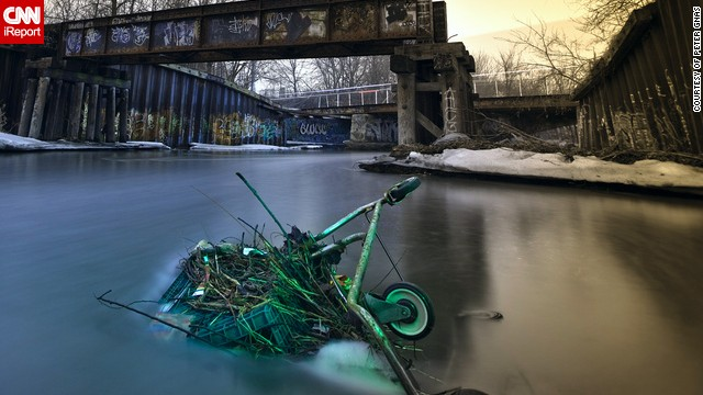 A cart sinks in the Kinnickinnic River in Milwaukee, Wisconsin.