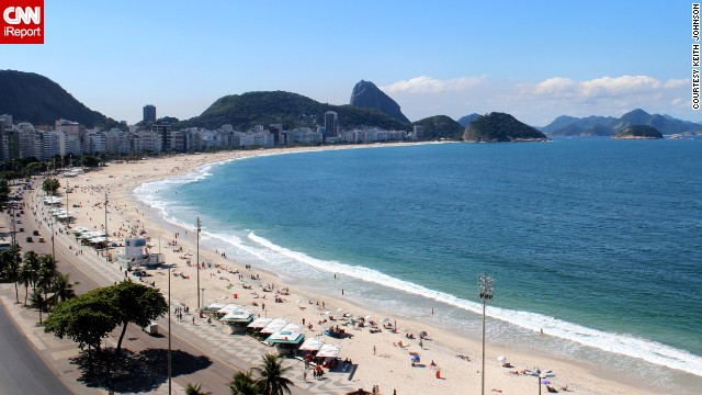 "Sugarloaf Mountain in the distance ""adds a beautiful backdrop for laying out on the sand and enjoying the Brazil sunshine"" at Copacabana Beach in Rio de Janeiro, said <a href='http://ireport.cnn.com/docs/DOC-1083063'>Keith Johnson</a>, who visited in May."