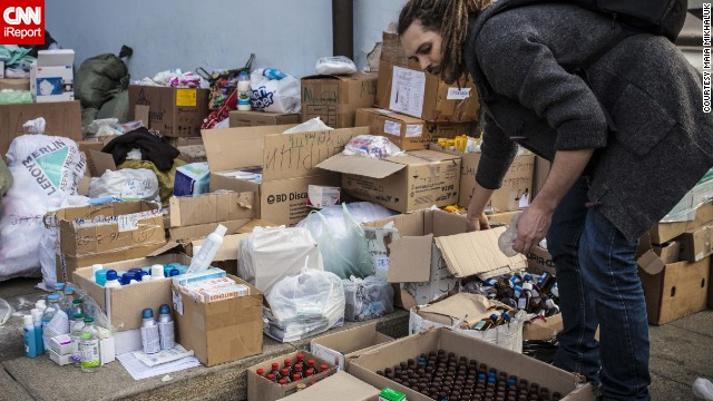 Volunteers sort though supplies a the the Mykhailovsky Cathedral in Kiev. The cathedral opened its doors for protesters wounded during the clashes with riot police Wednesday and Thursday.
