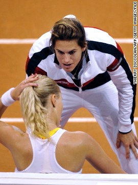 Long-standing Fed Cup representative Alize Cornet says Mauresmo -- seen here encouraging Kristina Mladenovic -- is the best captain she has played for during her six years on the team.