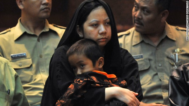 Darsem, an Indonesian maid who was convicted of murdering her employer, returns to West Java in 2011 after being pardoned.