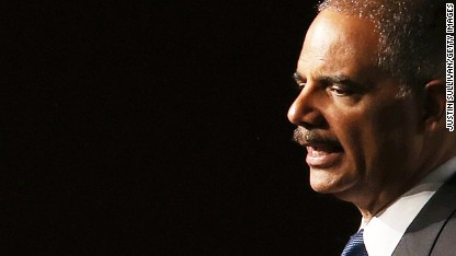 Eric Holder to Ferguson in bid to ease tensions over Brown shooting