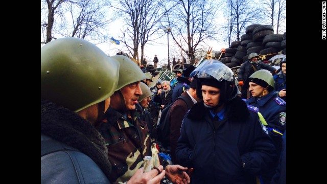 KIEV, UKRAINE: Defected policemen and anti-government protesters at barricades together in central Kiev on February 21. Photo by CNN's Fred Pleitgen. Follow Fred on Instagram at instagram.com/fpleitgencnn.