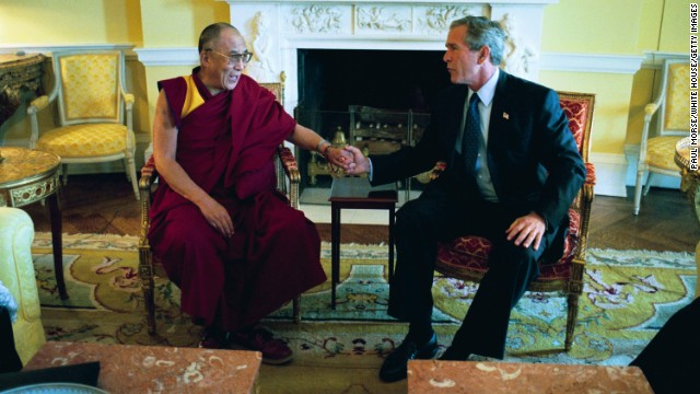 President George W. Bush meets the Dalai Lama at the White House in September 2003. (Photo by Paul Morse/White House/Getty Images)