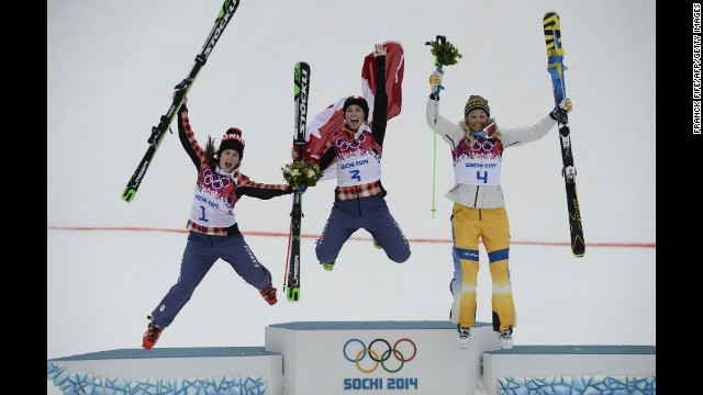 From left, silver medalist Kelsey Serwa of Canada, gold medalist Marielle Thompson of Canada, and bronze medalist Anna Holmlund of Sweden celebrate on the podium after the women's ski cross competi