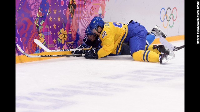 Finland's Sami Vatanen, left, vies for the pu