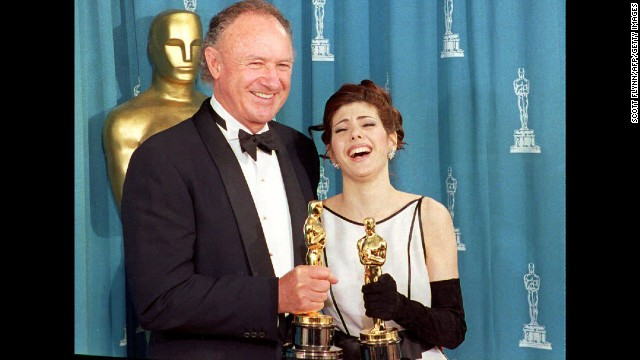 "Gene Hackman poses with Marisa Tomei in 1993 after he wins an Oscar for best supporting actor for his role in ""Unforgiven"" and she wins for best supporting actress for ""My Cousin Vinny."" Tomei's win is totally unexpected and still sometimes<a href='http://blogs.amctv.com/movie-blog/2008/07/my-cousin-vinny-marisa-tomei/' target='_blank'> (wrongly) contested.</a>"