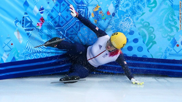 Elise Christie of Great Britain hits the wall while competing in a 1,000-meter short track semifinal.
