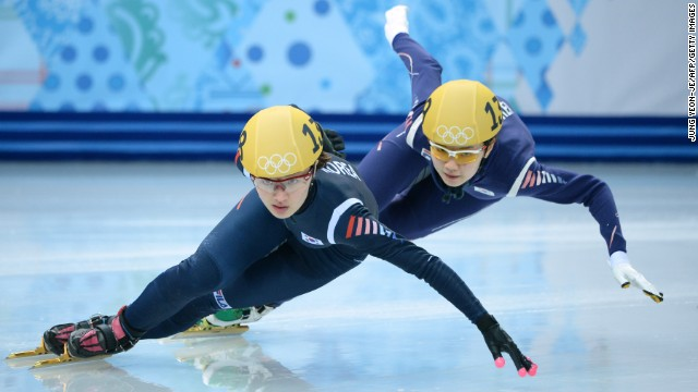 South Korea's Park Seung-Hi, left, and Shim Suk-Hee compete in the short track 1,000-meter final on February 21.