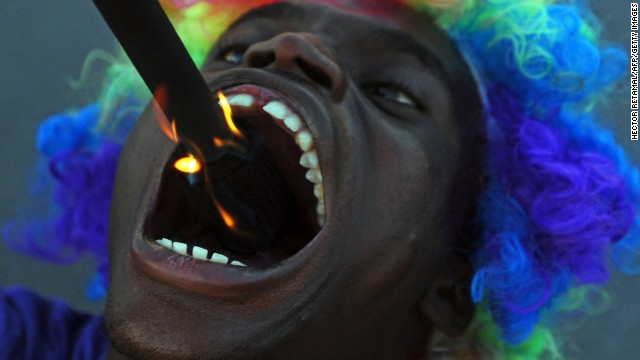 A fire-swallower performs during the Carnival of Delmas in Port au Prince, Haiti, on February 21.