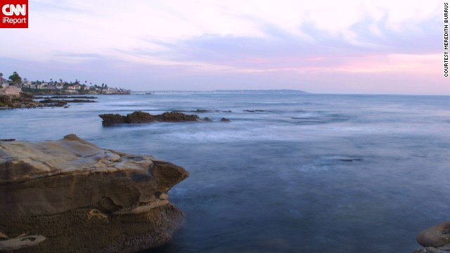 "<a href='http://ireport.cnn.com/docs/DOC-1093990'>Meredith Burrus</a> photographed the pastel colored sky over the calm waters of La Jolla, California, in February 2014. She says this spot is off the beaten path. ""Only a few people seem to know about this place and I'm always able to capture amazing sunsets here no matter what time of year it is,"" she said."