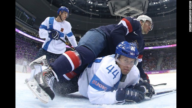 Ryan McDonagh of the United States falls on top of Kimmo Timonen of Finland on February 22 during the first period of the men's ice hockey bronze medal game.