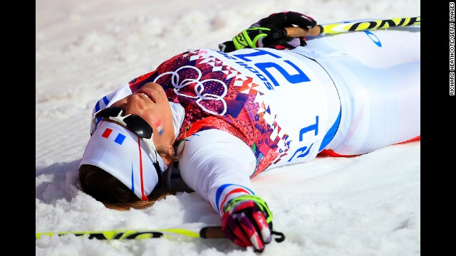 Coraline Hugue of France collapses after the women's 30-kilometer mass start free cross-country event on February 22.
