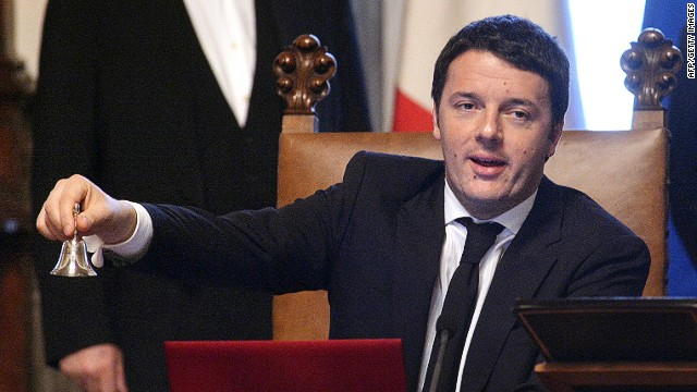 Matteo Renzi rings a silver bell, marking the start of his office, before the start of his first cabinet meeting on Saturday.